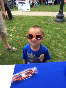 Little boy wearing MutualOne Bank sunglasses at Natick Days