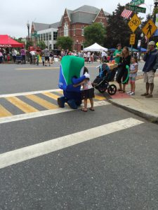 Mo hugging little girl at Natick Days