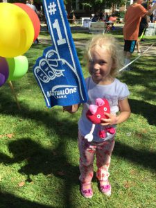 Little Girl holding foam finger at Natick Days
