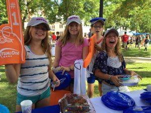 Girls having fun at MutualOne Bank booth at Natick Days