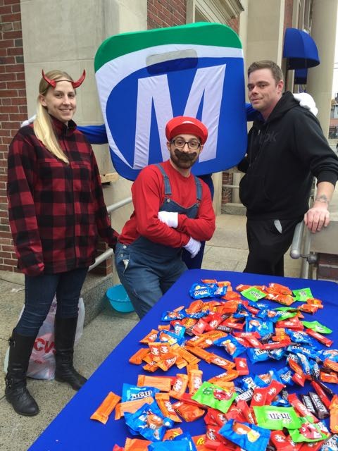 MutualOne Bank employees showing off their costumes at Natick Halloween Parade