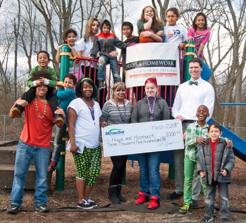 $3,500 Grant Benefits Hoops and Homework Program Staff and students at Hoops and Homework of Framingham gather to celebrate MutualOne Charitable Foundation's recent donation to the after-school program.
