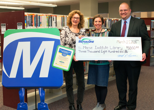 Morse Institute Library receives $3,800 donation from MutualOne Bank.