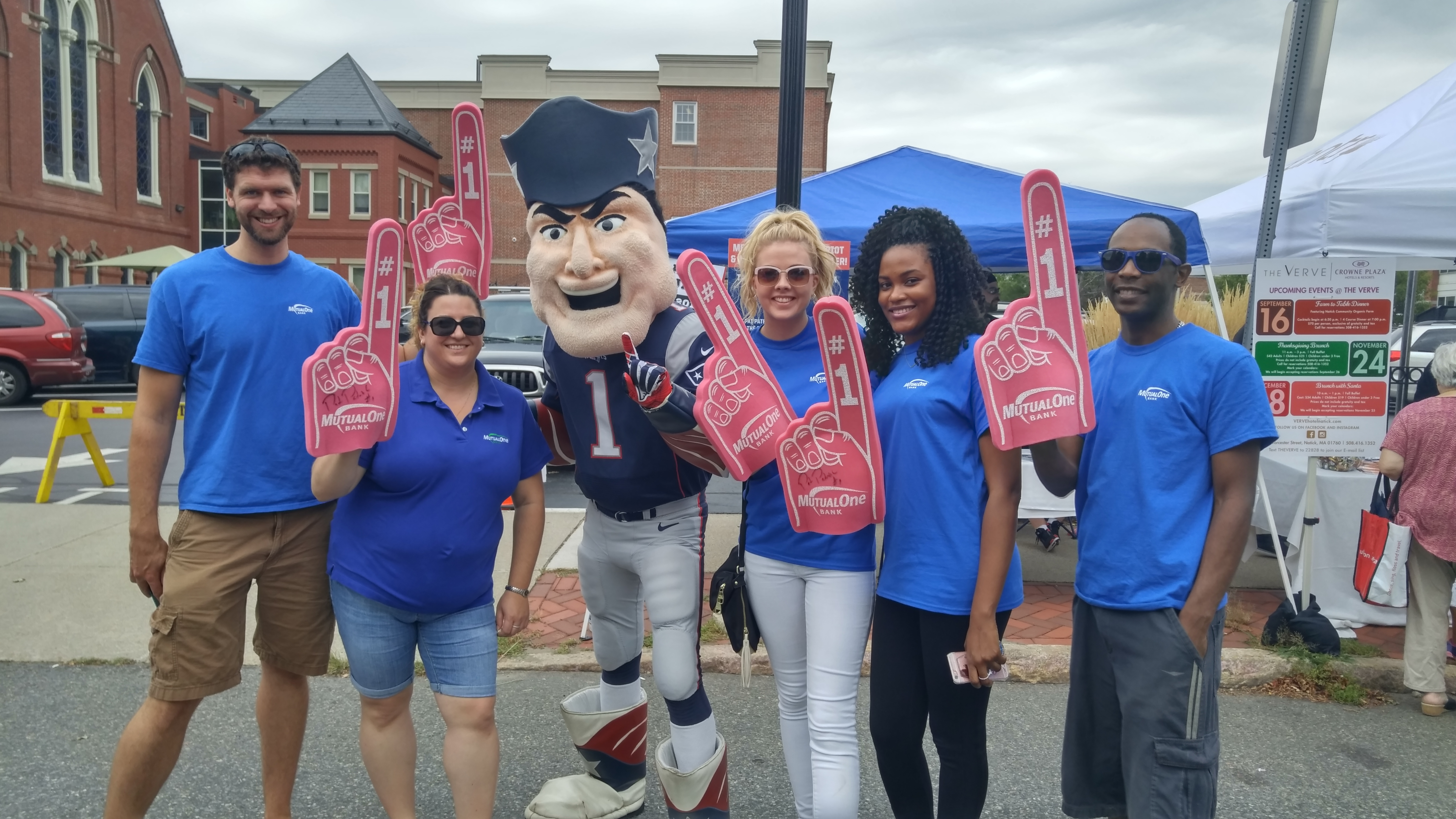 MutualOne Bank employees wearing foam fingers with Pat the New England Patriots' mascot at Natick Days