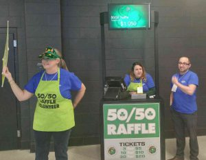 MutualOne Bank employees selling 50/50 raffle tickets at Boston Celtics game
