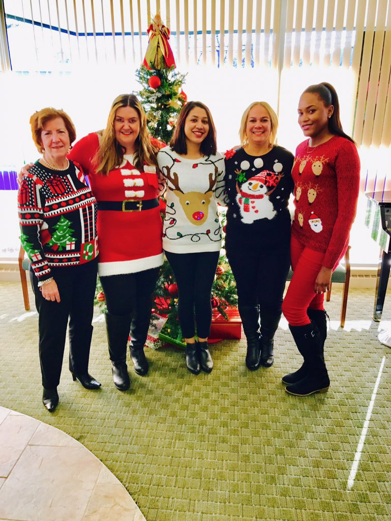 MutualOne Bank employees in their ugly sweaters