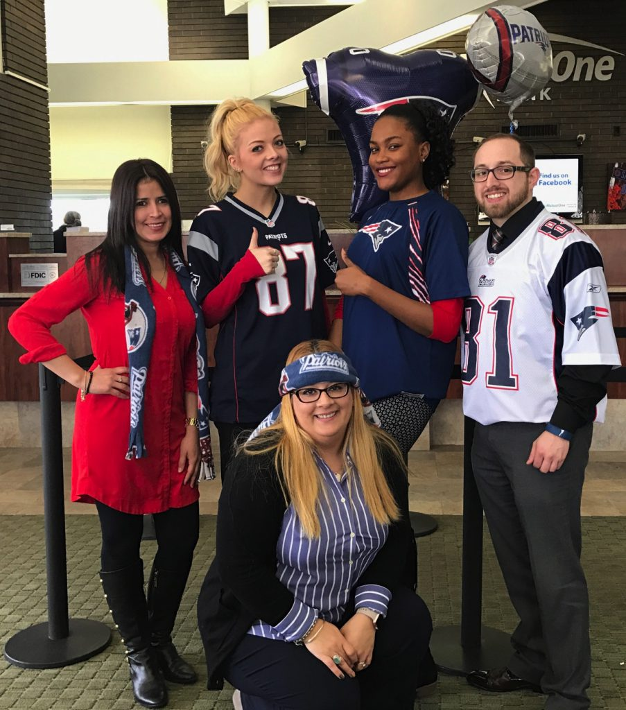 MutualOne Bank employees wearing New England Patriots spirit-wear