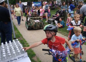 July 4th 2017 Parade kid gets water