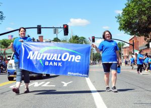 July 4th 2017 MutualOne employees hold our banner