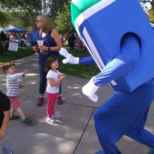 Natick Days Mo giving high five to two children