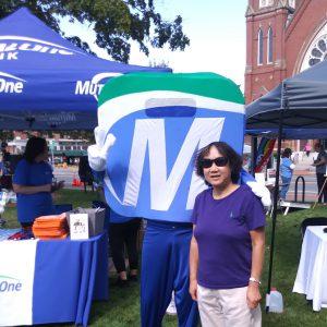 Natick Days Mo with woman at MutualOne tent