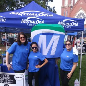 Natick Days Mo with three people at MutualOne tent