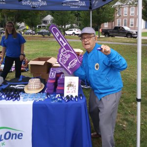 MetroWest Humane Society Craft Fair Man with large purple foam finger