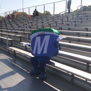 Mo sitting on bleachers