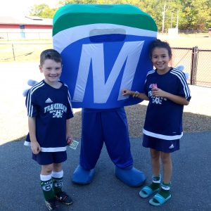 Mo with two kids wearing Framingham Soccer shirts