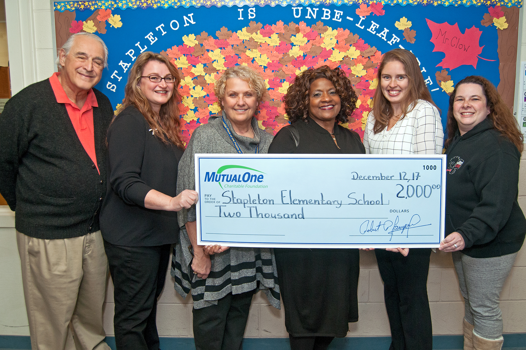 Celebrating MutualOne Charitable Foundation's recent $2,000 grant to the Stapleton Elementary School's STEAM night are (l-r) Volunteers Allan Rosenberg and Michelle Rosenberg; Allison Benabdallah, Stapleton assistant principal; Jean Hoskins, MutualOne Bank's Concord Street, Framingham office manager; Heather Allen, Grade 3 teacher and STEAMathon co-chair; and volunteer Meredith Wolff.