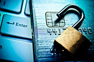Keyboard, credit card, open lock with blue lighting