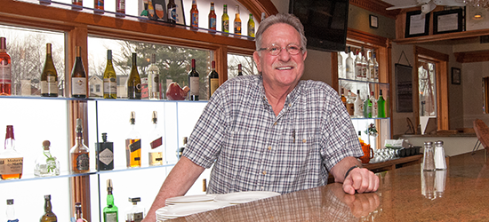 Lee Mencoboni behind the bar at La Cantina Italiana