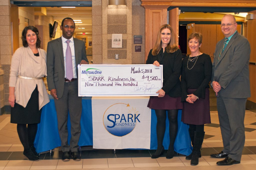 Charitable Foundation check presentation to SPARK Kindness