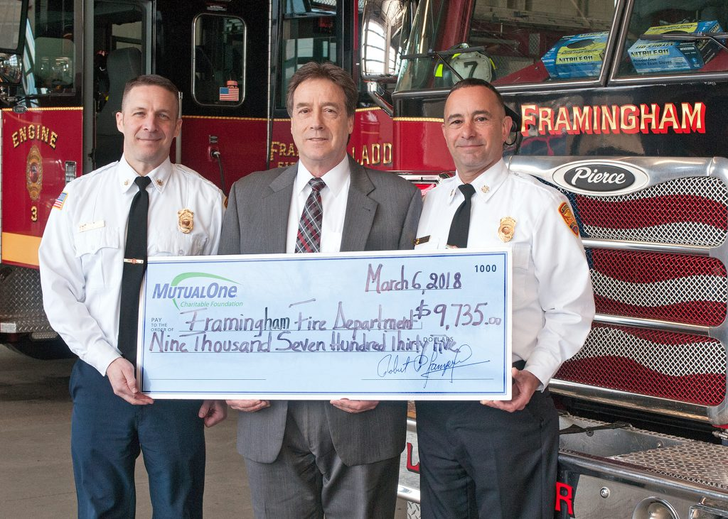 Observing the recent $9,735 MutualOne Charitable Foundation grant to the Framingham Fire Department for the introduction of a new proactive public safety plan in the city's schools are (from left) Michael Dutcher, Assistant Chief for the Framingham Fire Department; Mark R. Haranas, President and CEO of MutualOne Bank; and Joseph C. Hicks, Chief of Department for the Framingham Fire Department.