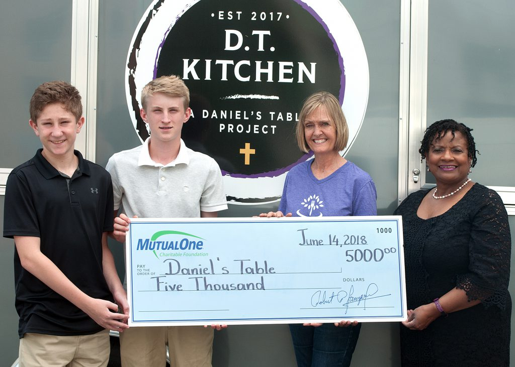 Celebrating MutualOne Charitable Foundation's $5,000 grant to Daniel's Table are (l-r) Kevin Rosoff and Jake Rymsza, volunteers at Daniel's Table; Alicia Blais, co-founder of Daniel's Table; and Jean Hoskins, manager at MutualOne Bank's Lincoln Street, Framingham office.